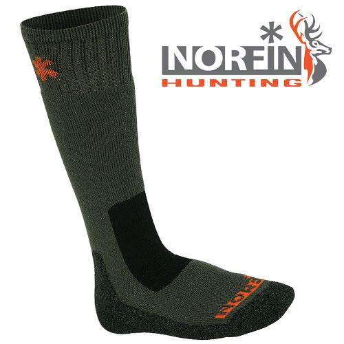 Носки Norfin Hunting 740 (XL, 740-XL)Носки<br>Носки Norfin Hunting 740 р.L разм.L/мат.75%акрил,20%полиэстер,5%эластик/темп. <br>Холодно Носки с содержанием высококачественного <br>акрила, отводящего излишнюю влагу от ступней <br>ног и удерживающего тепло. Эластичные носки <br>хорошо облегают ступню и щиколотку, удобны <br>и приятны в носке.<br><br>Пол: мужской<br>Размер: XL<br>Сезон: зима<br>Цвет: зеленый